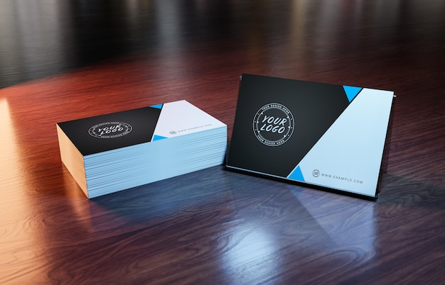 White business card pile on wooden surface mockup