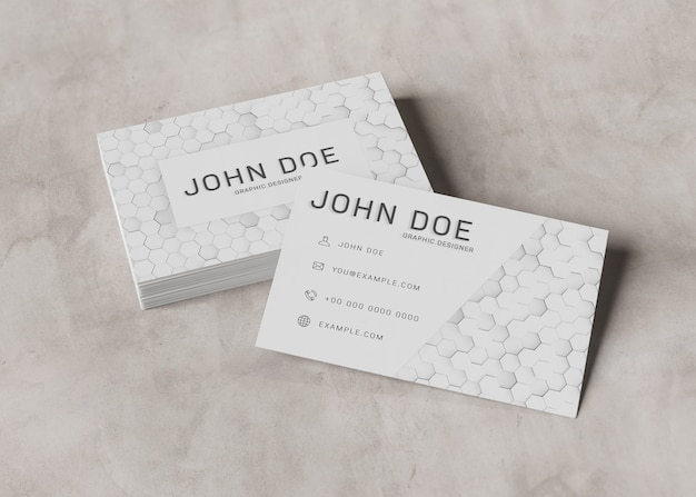 White business card piles on concrete surface mockup