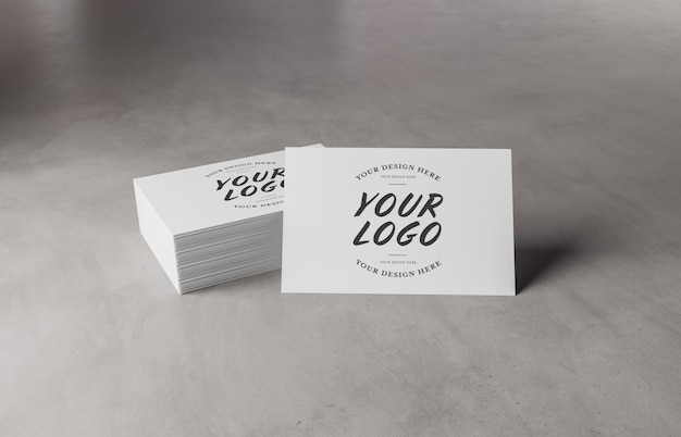 White business card stack on concrete surface mockup