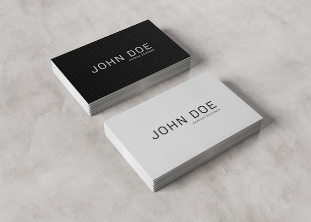 White business card stack on concrete surface
