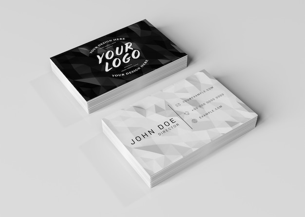White business card stack on white surface mockup
