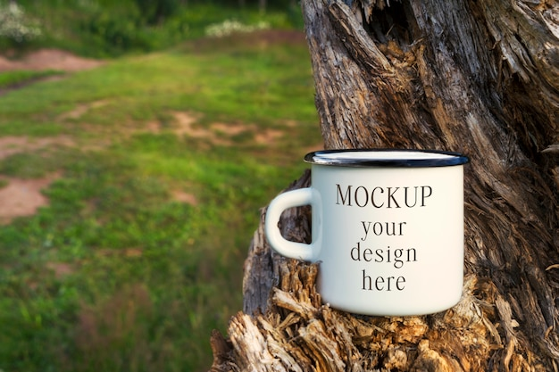 White campfire enamel mug mockup with tree stump