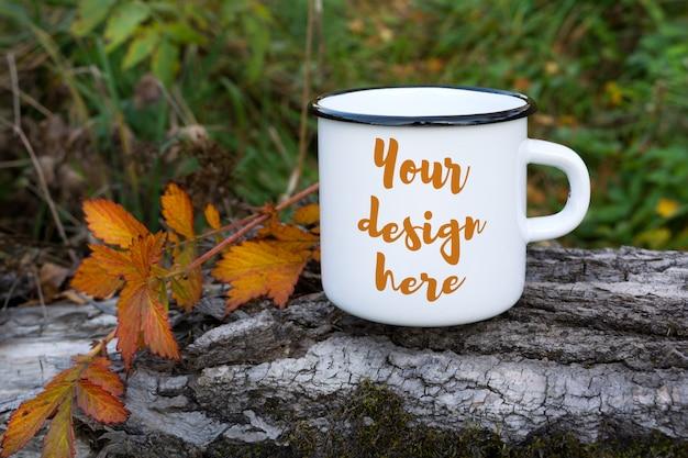 White campfire mug mockup with orange leaf