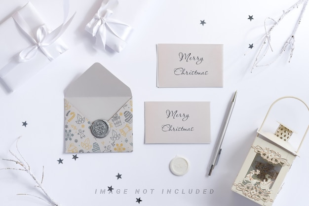 White christmas background with mockup letter, pen and lantern.