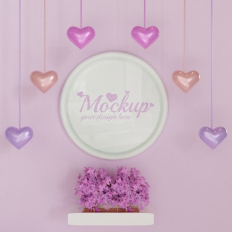 White circle frame mockup on pink wall with pink leafy plants and heart shaped hanging decoration