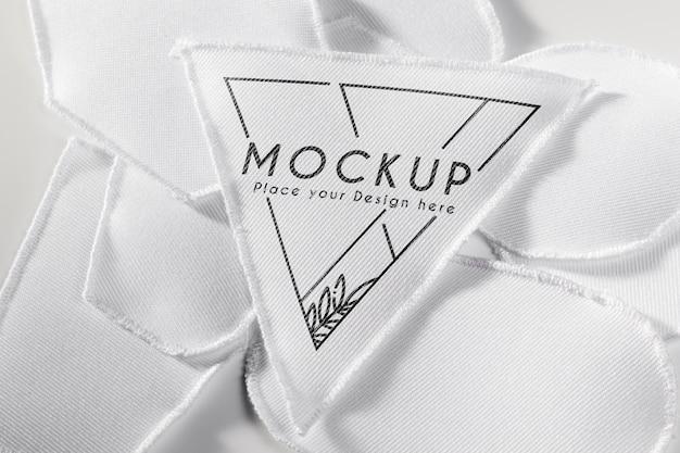Белый макет ткани нашивки одежды