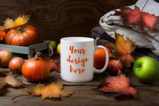 White coffee mug mockup with fall leaves, pumpkins