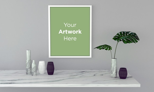 White empty photo frame with green plant in vase