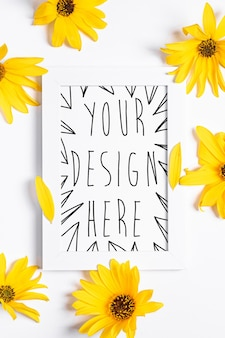 White empty picture frame mock up with yellow flower on white, flat lay