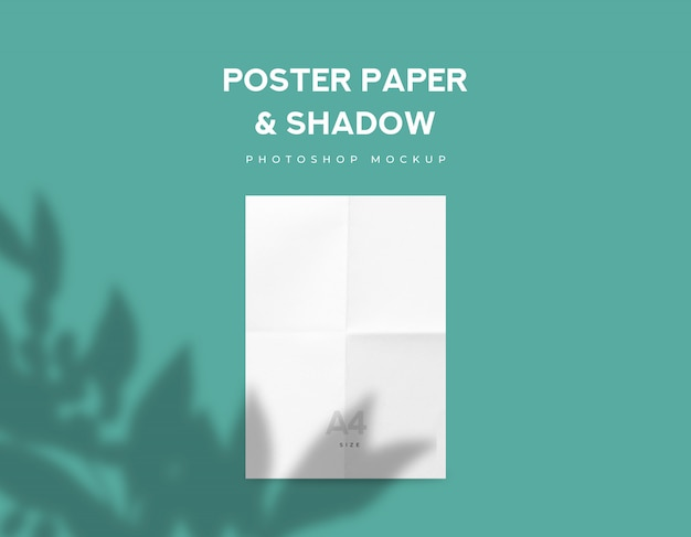 White fold poster paper or flyer a4 size and leaves shadow on green mint background