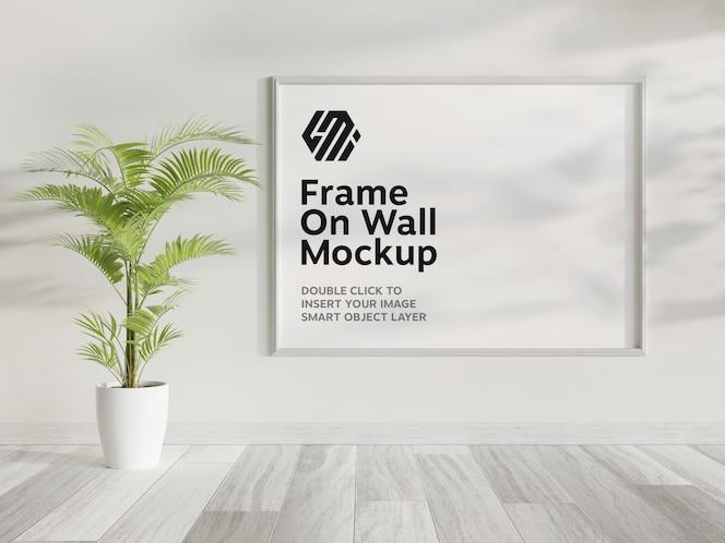 White frame hanging on wall mockup