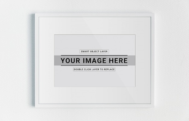 White frame hanging on a white wall mockup
