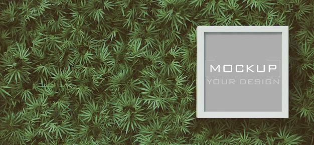 White frame mockup on cannabis leaves background