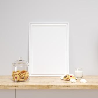 Белая рамка макет на кухонном столе с вкусным печеньем