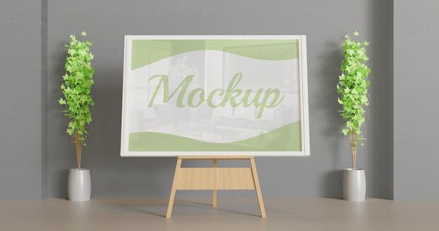 木製イーゼルの白いフレームモックアップ。シンプルな縦型フレームのモックアップ。