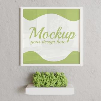 植物の壁に白いフレームモックアップ