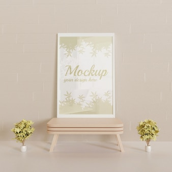 White frame mockup on standing on the mini wooden table with couple decorative plants