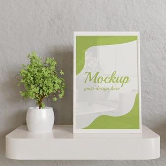 White frame mockup on white wall desk