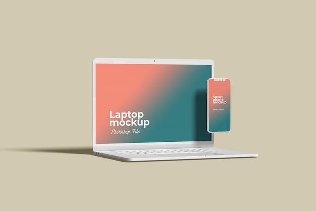흰색 노트북 및 스마트 폰 모형 측면 각도보기