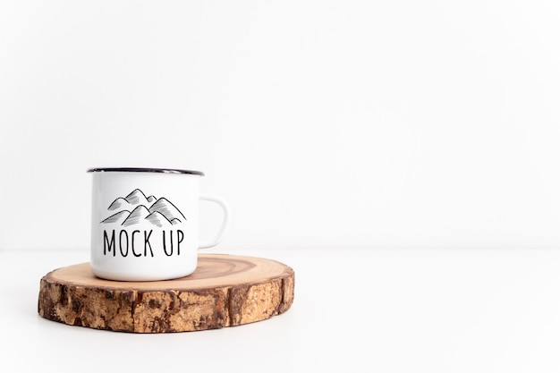 White mug on rustic wooden cut section mockup.