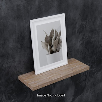 White photo frame mockup on wooden shelf
