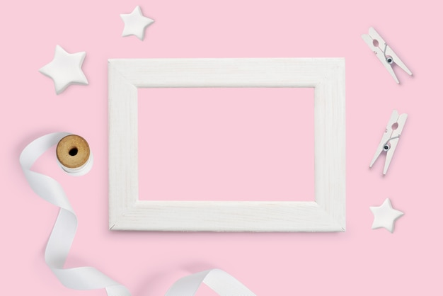 White picture frame on pink