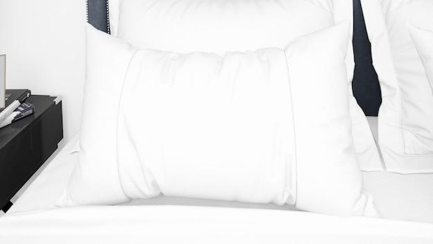 Белая подушка на кровати, крупным планом