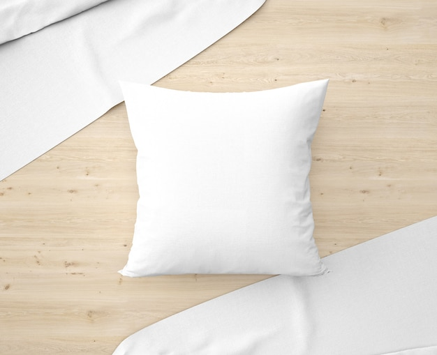 White pillow with bedsheets on the floor