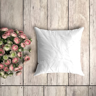 White pillowcase mockup on a wooden plank with floral decoration