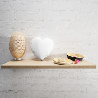 White soft pillow and lamp on a wooden shelf