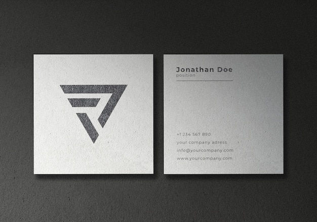 White square business card mockup on black textured background
