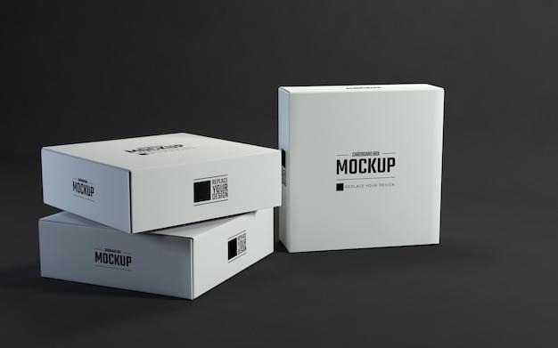 暗い背景のモックアップをパッケージ化する白い正方形の段ボール箱