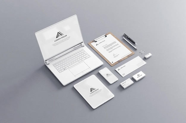 White stationery mockup business company with laptop tablet phone