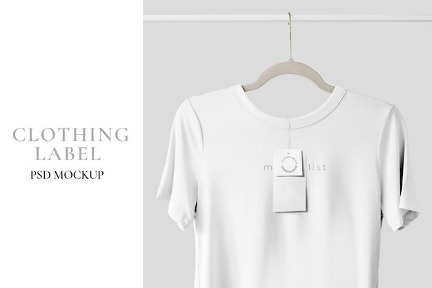White t-shirt mockup hanging on a clothing rack