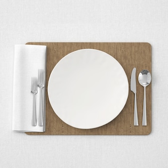 White table setting on wooden mat