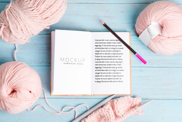 Winding wools and mockup notebook for notes and knitting pattern