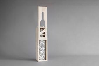 Wine bottle in wooden box mockup