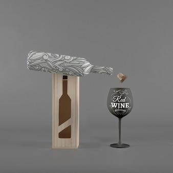상자와 유리 와인 병 이랑