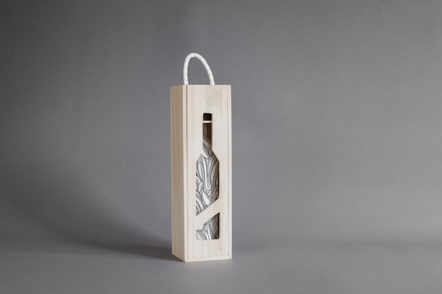 Wine bottle in wooden box mockup