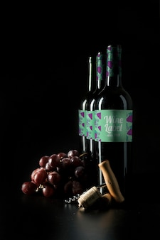 Wine mockup with bottles in row and grapes
