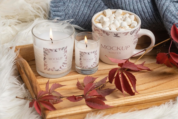 Winter hygge arrangement with mug and candle mock-up