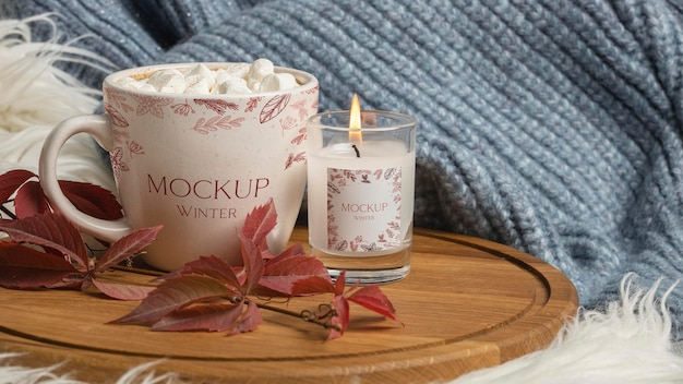 Winter hygge assortment with mug and candle mock-up
