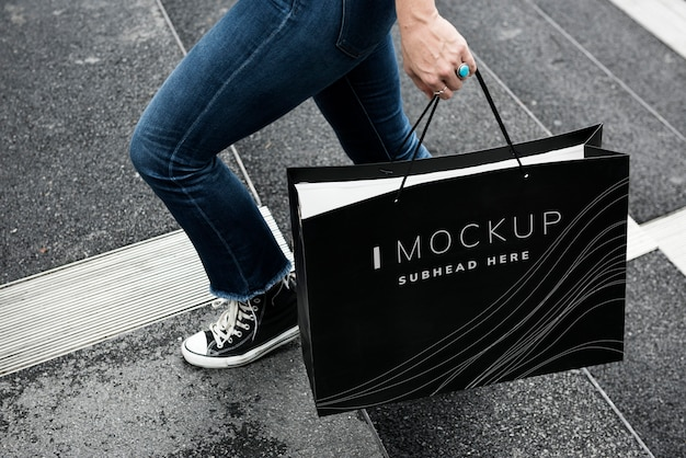 Woman carrying a shopping bag mockup