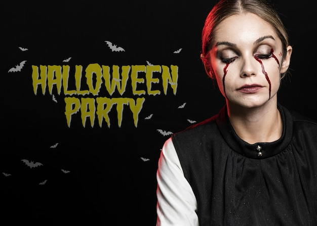 Woman crying blood with eyes closed make-up for halloween