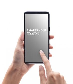女性の手持ち株モックアップブラックスマートフォンと触れます。