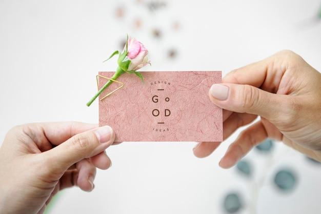 Woman handing a name card mockup