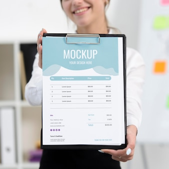 Woman holding a blue mock-up clipboard