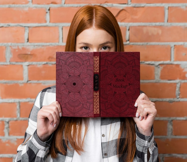 Woman holding book mock-up