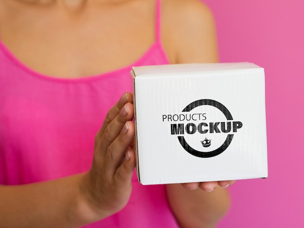 Woman holding box mock-up