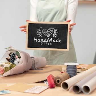 Woman holding a chalkboard mock-up